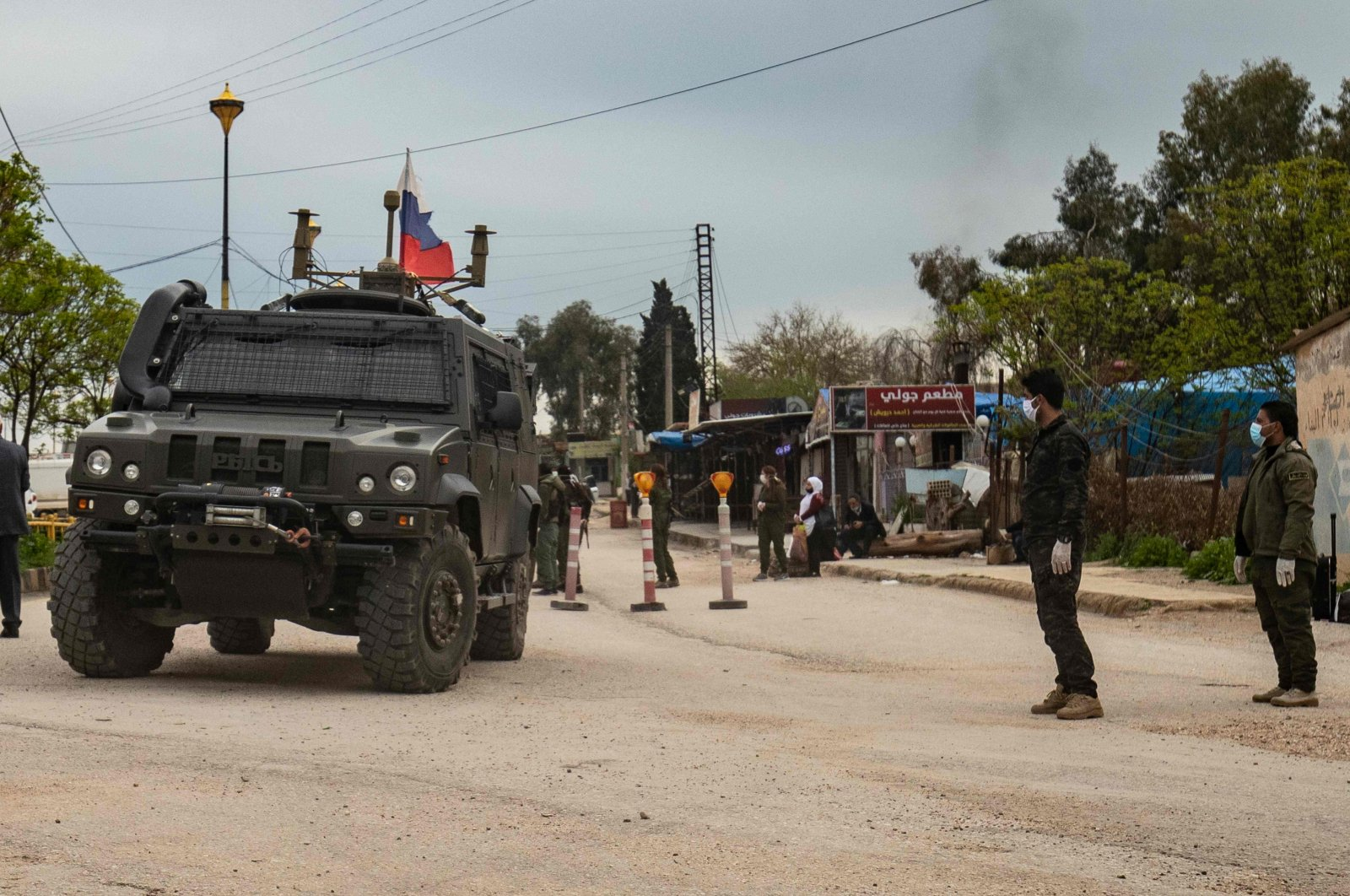 A Russian military vehicle drives in the vicinity of Qamishli airport, which has been turned into their military base, in Syria's northeastern Hasakeh province, Thursday, April 5, 2020. (AFP)