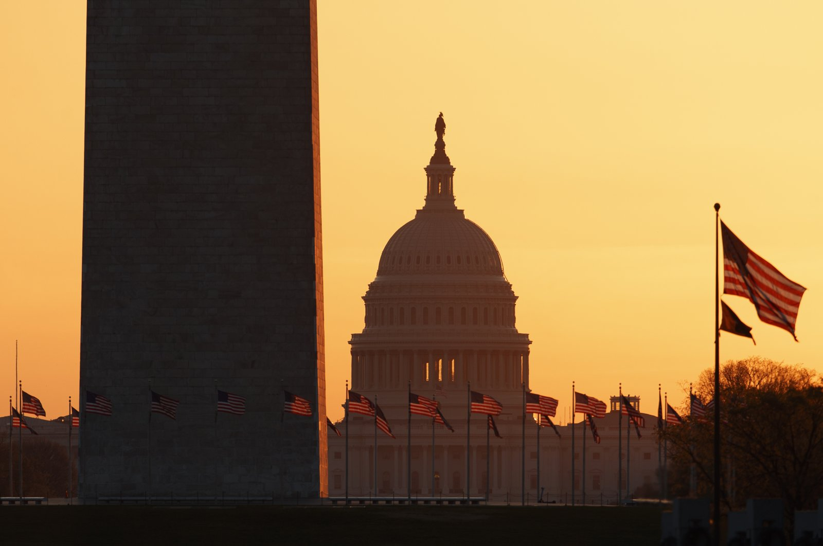 The Washington Monument and the U.S. Capitol are seen in Washington, at sunrise, Wednesday, March 18, 2020. (AP Photo)
