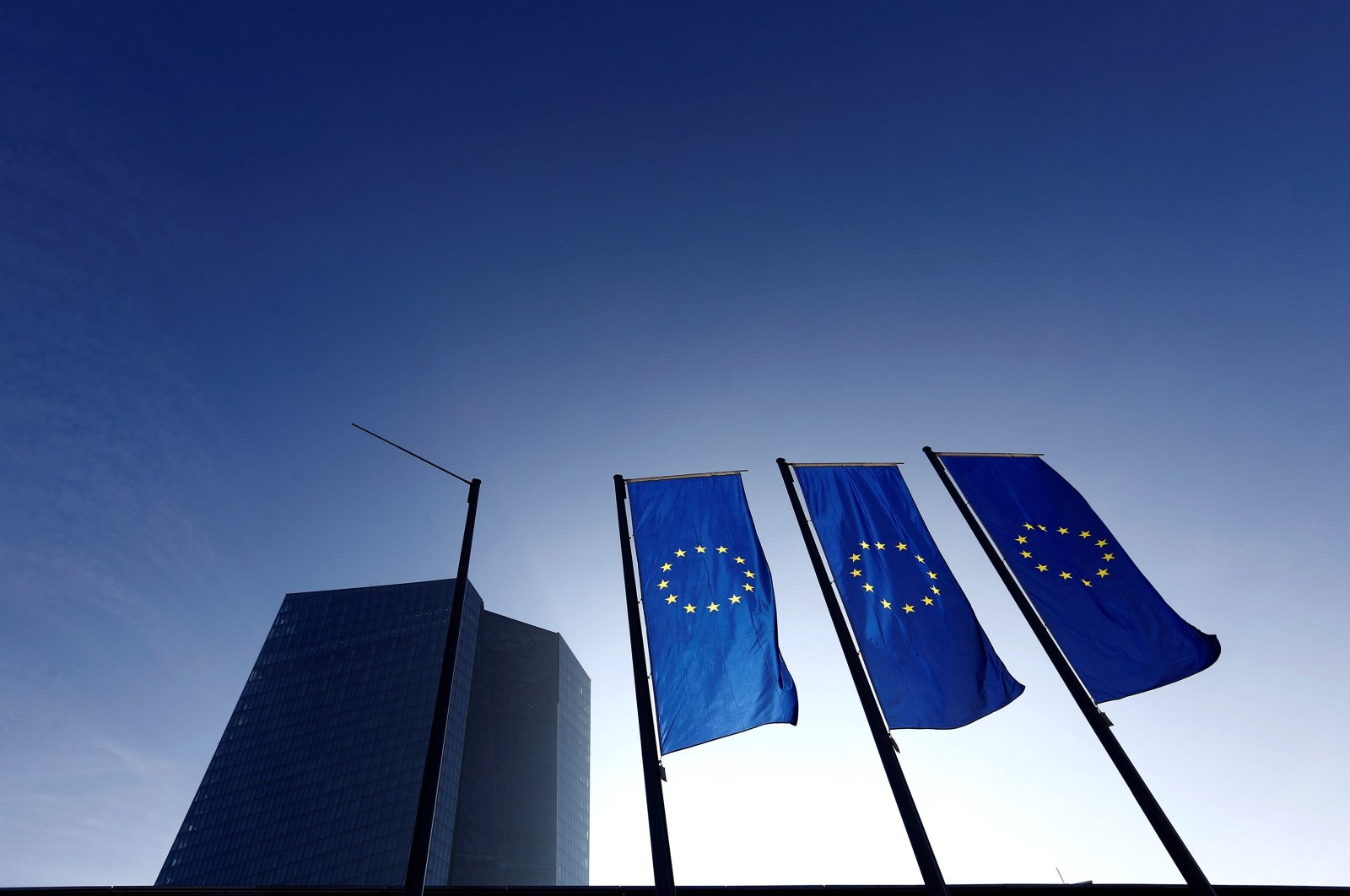 This undated photo shows EU flags outside the European Central Bank (ECB) headquarters, Frankfurt, Germany. (REUTERS Photo)