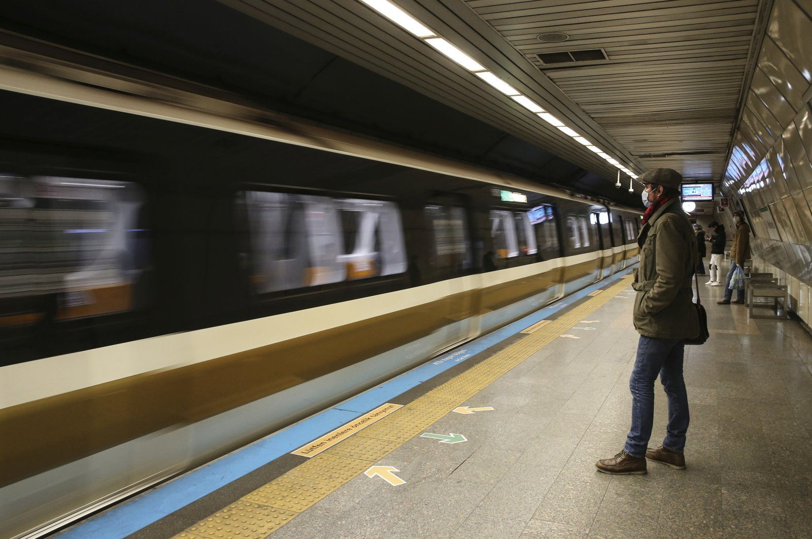 A commuter wears a mask in an underground station during the coronavirus outbreak in central Istanbul, Friday, April 3, 2020. (AP Photo)