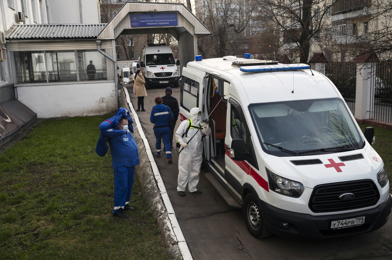 A medical worker disinfects an ambulance after transferring a patient suspected of having the coronavirus to a hospital in Moscow, Russia, April 9, 2020. (AP Photo)