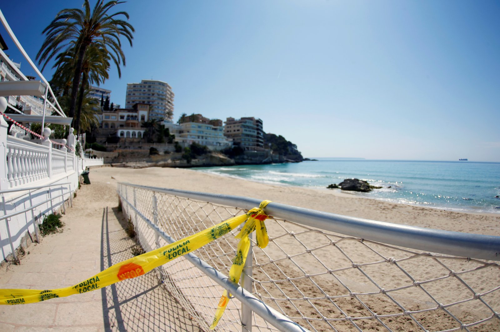 Police tape restricts access to a beach in Cala Major during the COVID-19 outbreak in Mallorca, Spain, April 9, 2020. (Reuters Photo)