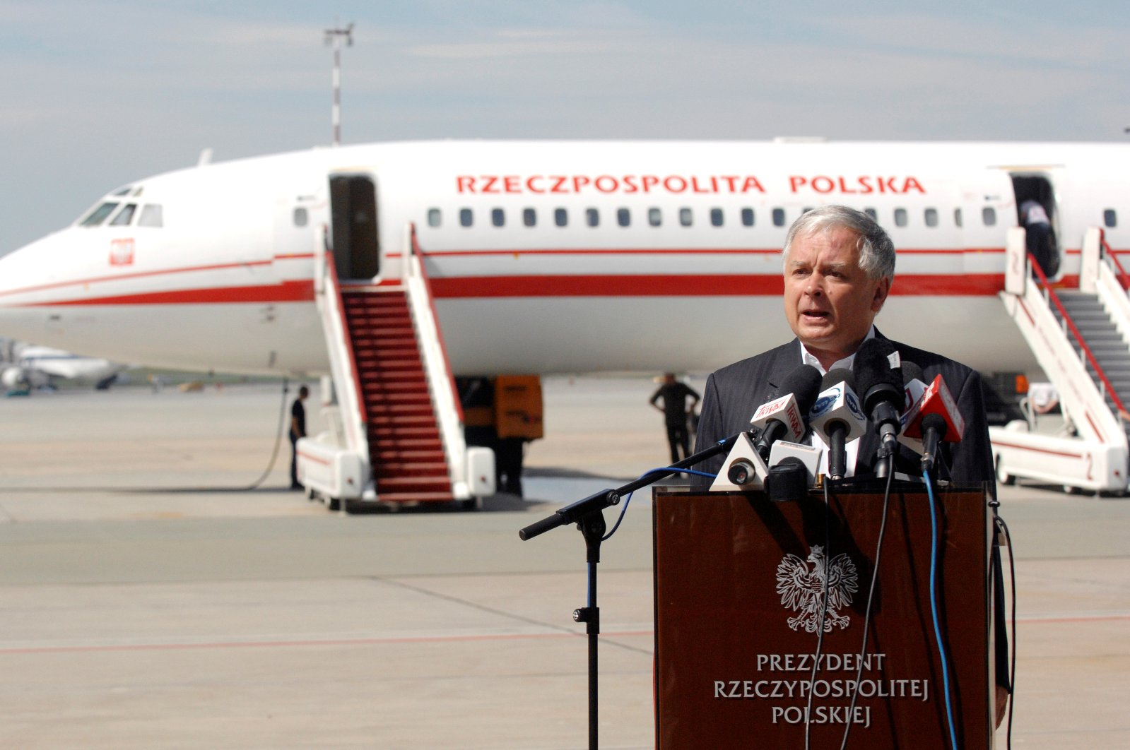 Polish President Lech Kaczynski speaks in front of the government Tupolev Tu-154 aircraft at Krakow airport, Poland, Aug. 8, 2008. (Reuters Photo)