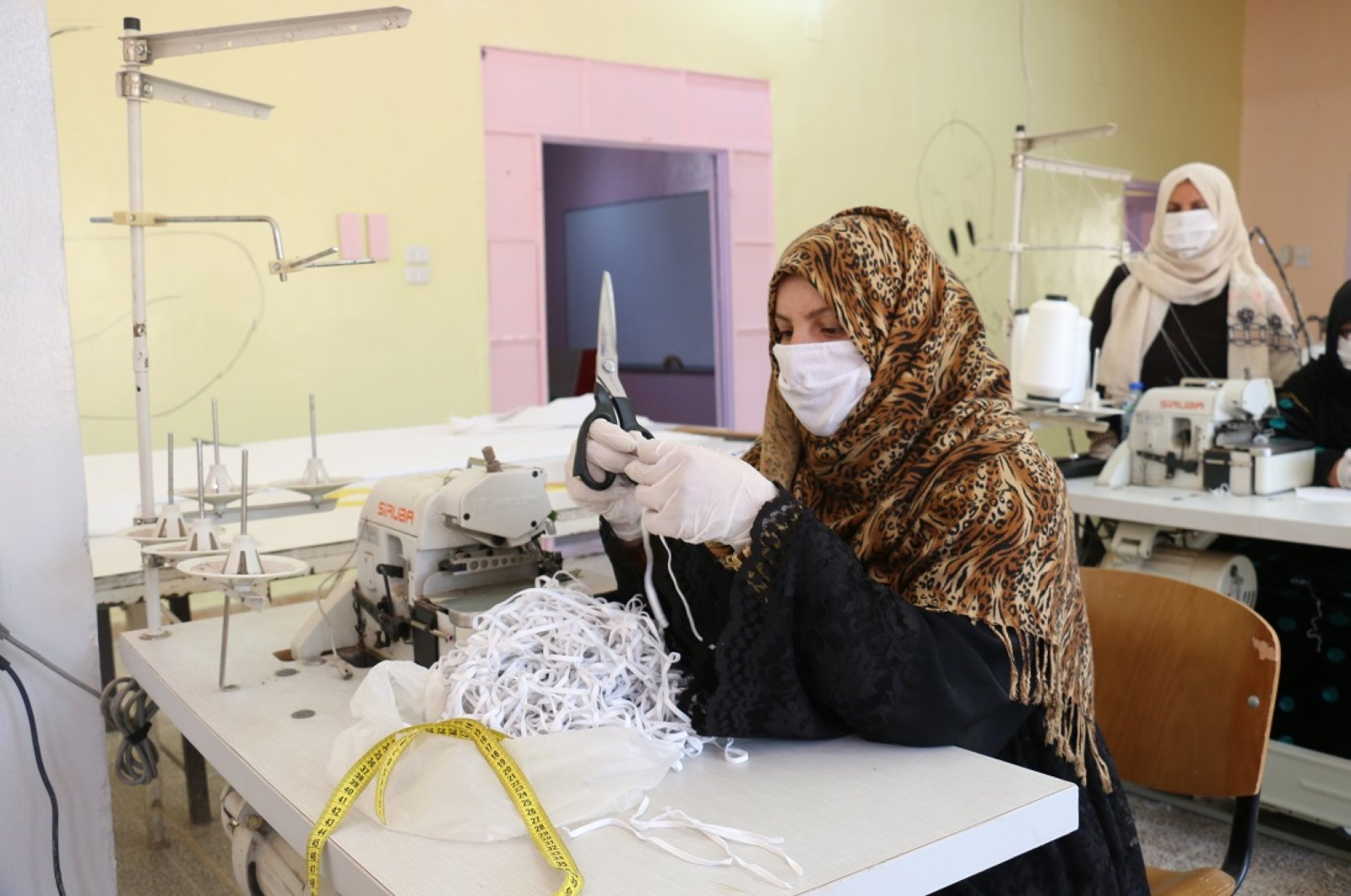 1,000 masks will be produced by 12 trainee women every day at a workshop in Ras al-Ayn as part of measures against coronavirus, Thursday, April 9, 2020.
