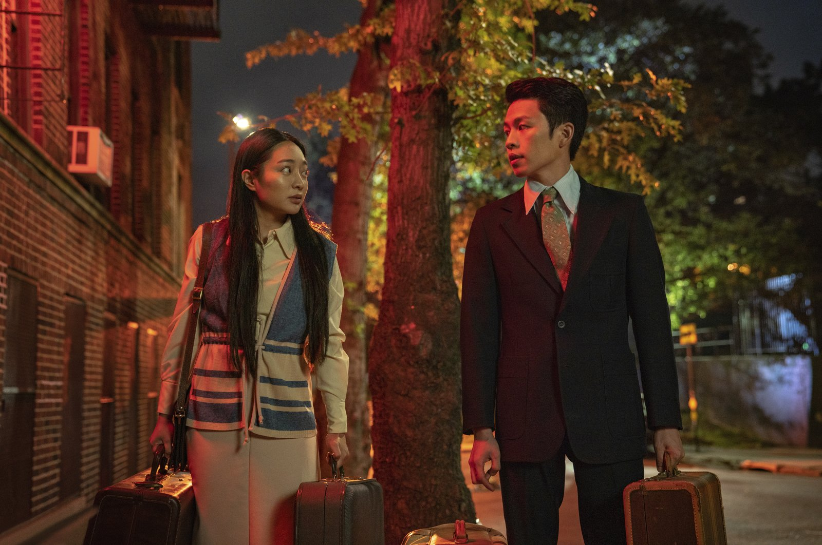 """In this image released by Netflix, Kunjue Li (L) and Hong Chi appear in a scene from """"Tigertail."""" (AP Photo)"""