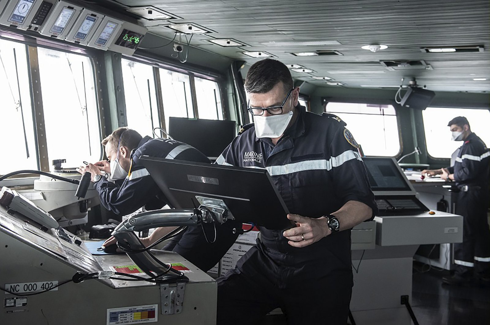 Sailors wear face masks aboard the French aircraft carrier Charles de Gaulle, in the Atlantic Ocean, April 8, 2020. (AP Photo from the French Navy)