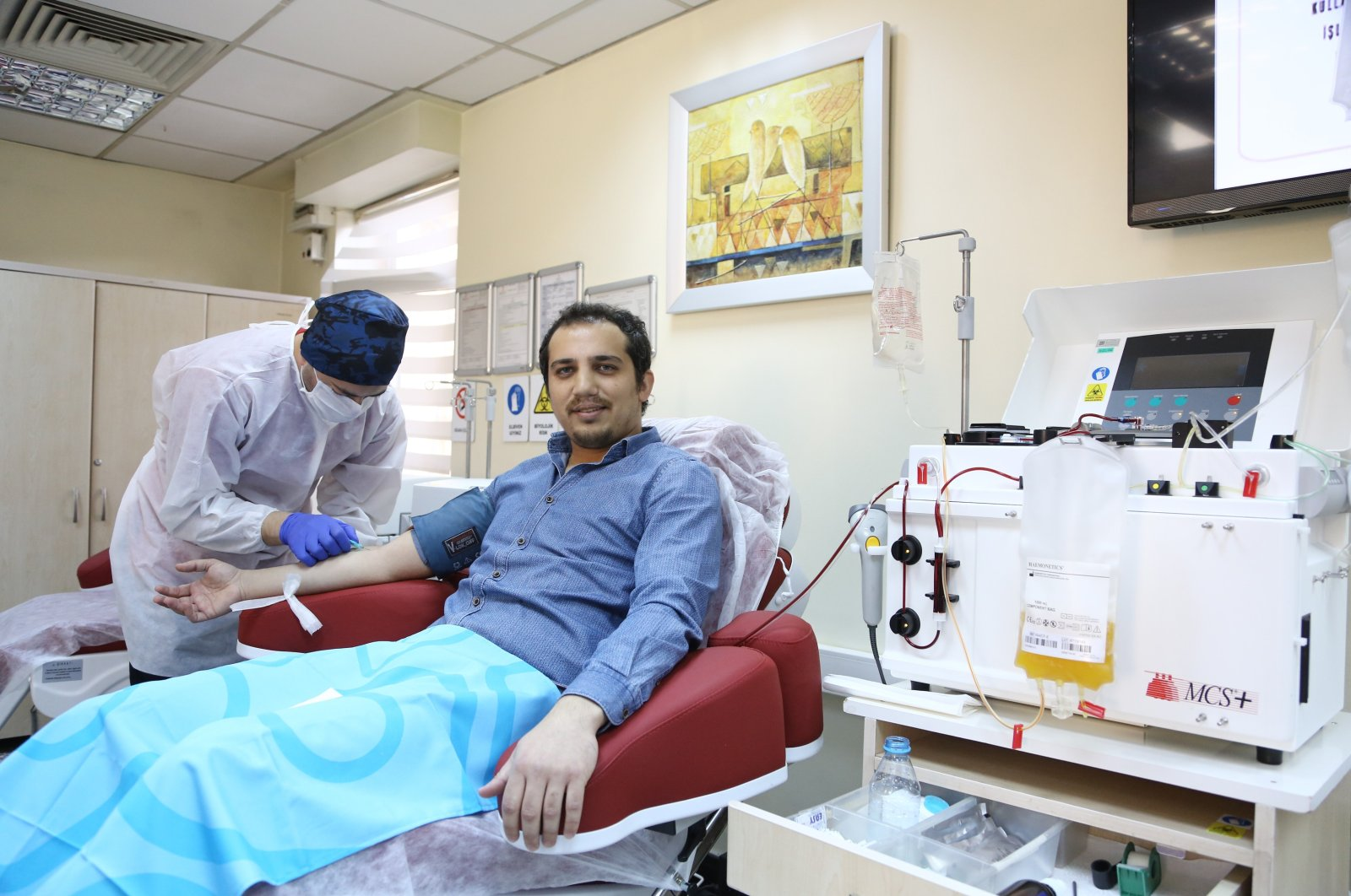 Dr. Kürşat Demir, a recovered COVID-19 patient, donates plasma to the Turkish Red Crescent, Ankara, Turkey, April 7, 2020. (AA Photo)