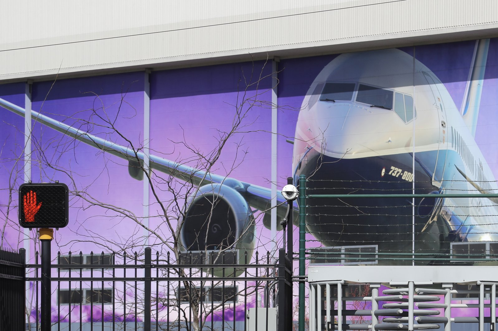 An image of a Boeing 737-800 airplane is shown on a building at Boeing Co.'s airplane assembly facility in Renton, Washington, U.S., April 6, 2020. (AP Photo)