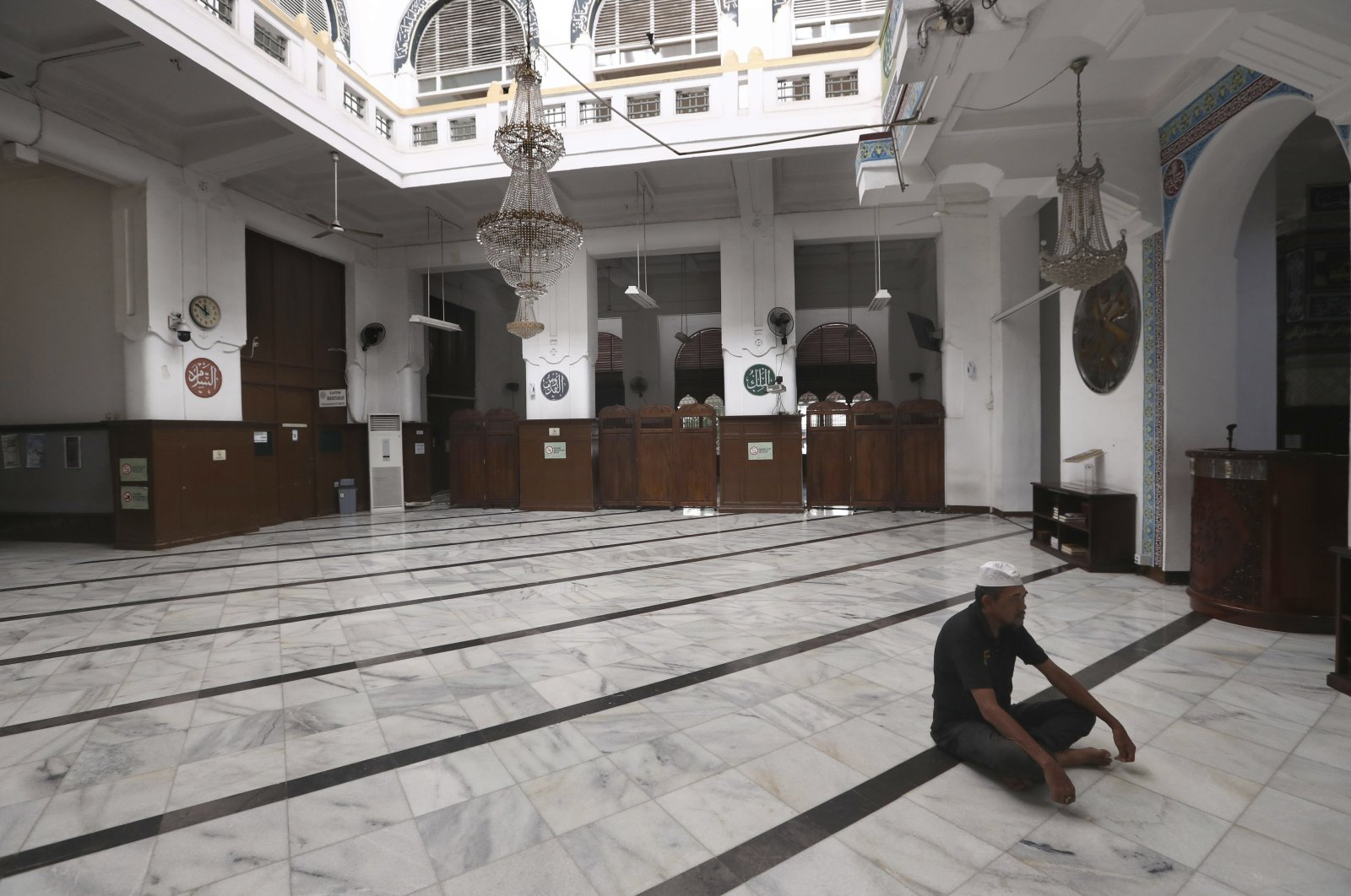 A man prays at an empty mosque in Jakarta, Indonesia, April 10, 2020. (AP Photo)