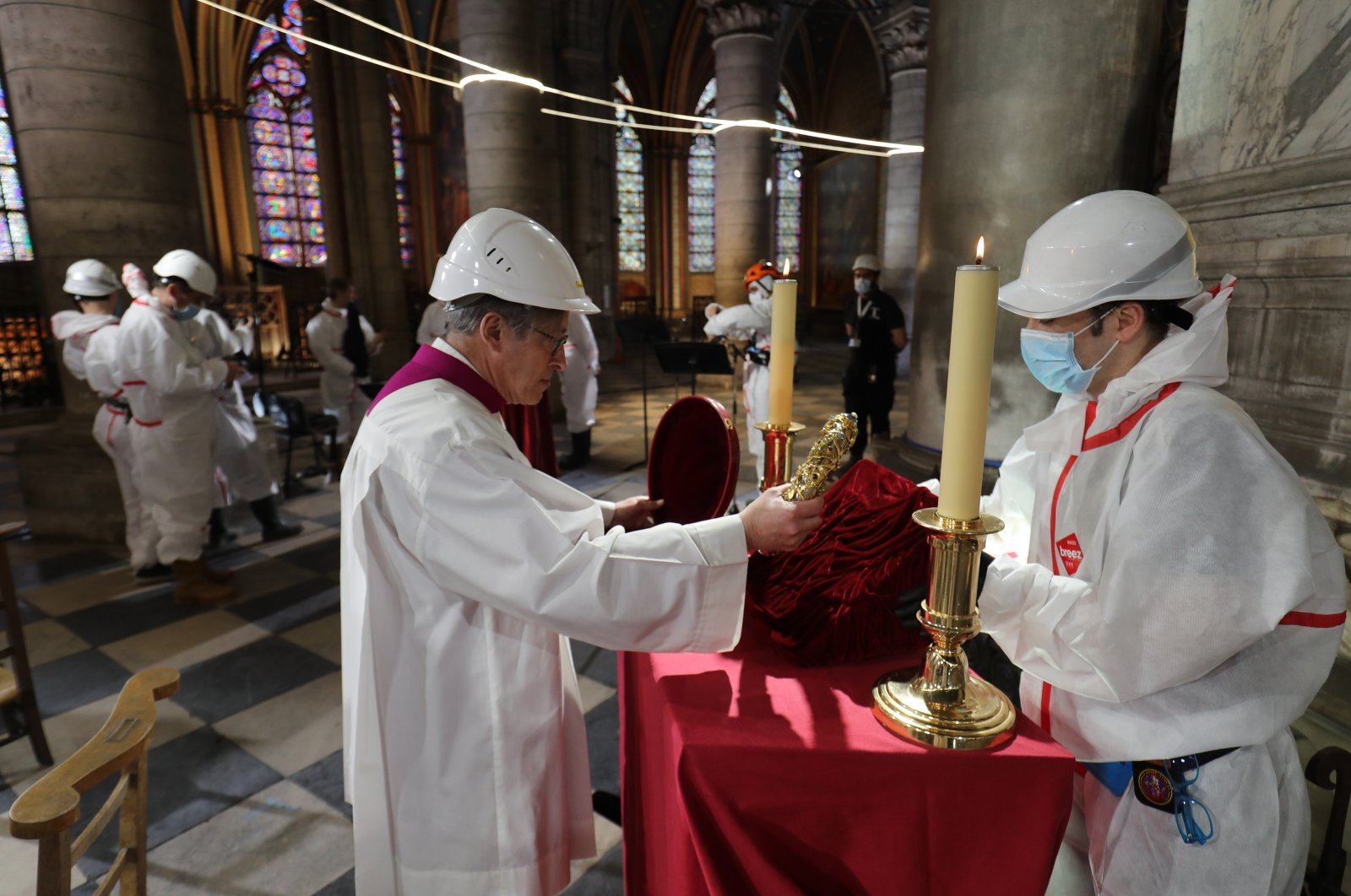 In a secured part of the Notre Dame Cathedral, its rector, Patrick Chauvet, holds the Crown of Thorns during a ceremony to celebrate Good Friday in Paris, France, April 10, 2020. (AP Photo)