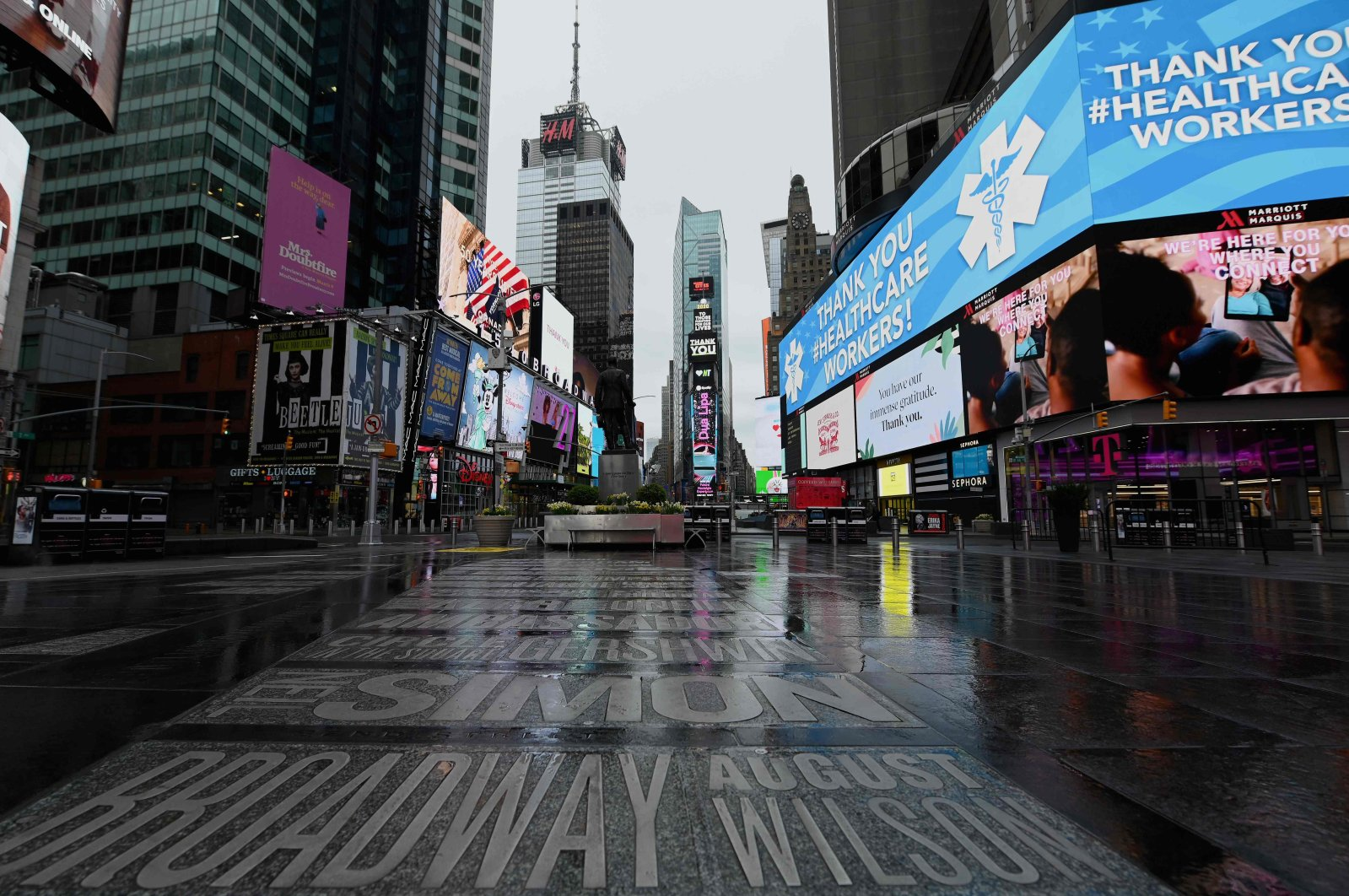 A view of a nearly empty Time Square on April 09, 2020 in New York City, as another 6.6 million US workers file for unemployment benefits for the week ending April 4, 2020. (AFP Photo)