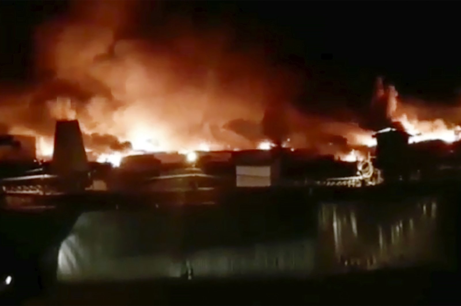 """In this image taken from video provided by Instagram account @incident.38, a fire is blazing at a prison colony where inmates and guards have clashed in Angarsk, 4,000 kilometers (2,500 miles) east of Moscow, Friday, April 10, 2020. Russian officials say a large fire is blazing at a prison in Siberia where inmates and guards have clashed. There was no official information about casualties or damage Friday, but Pavel Glushenko, a local human rights activist, said on social media that """"full-scale hostilities"""" were taking place at the maximum-security prison. (AP Photo)"""