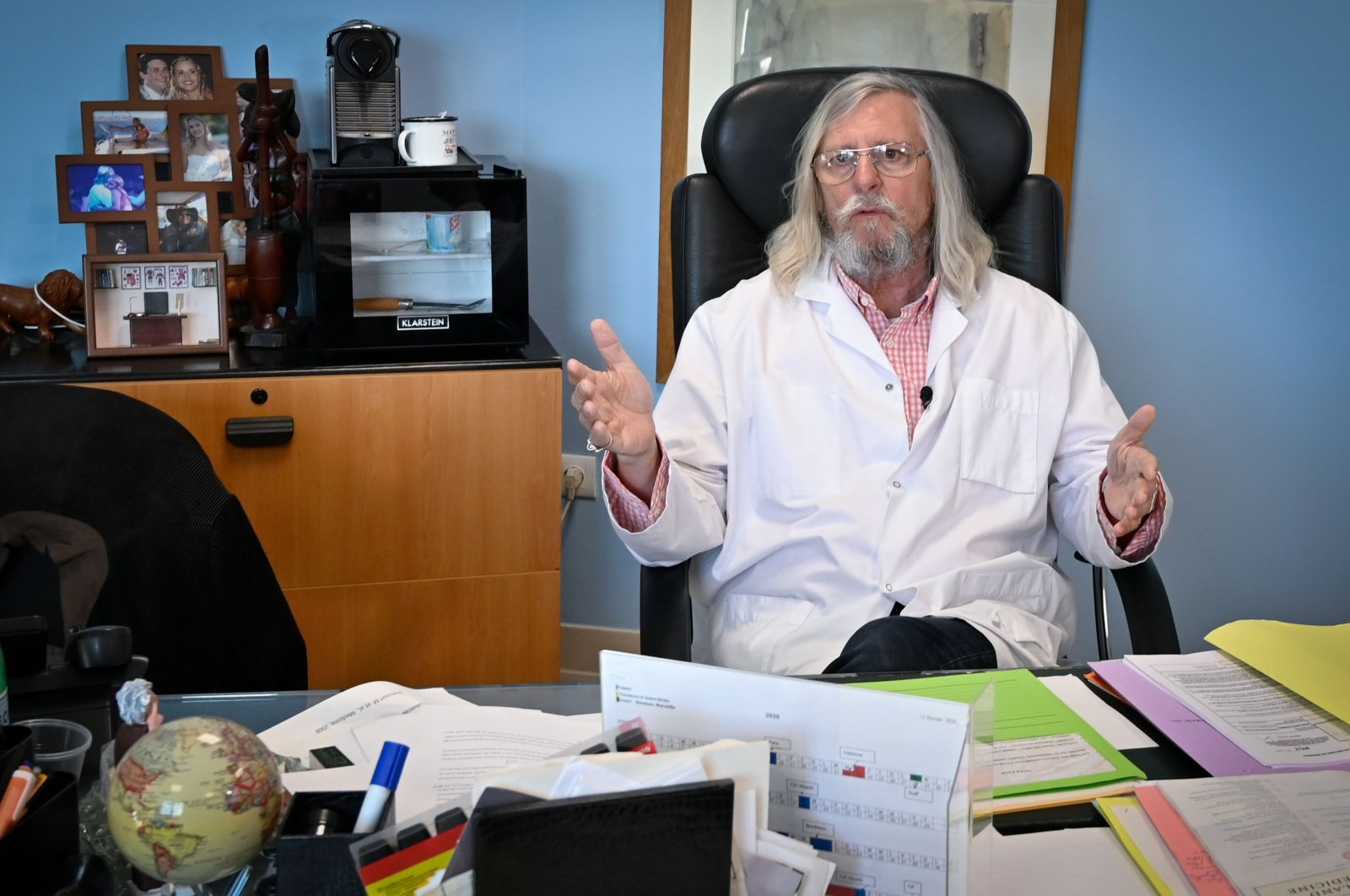 In this file photo taken on Feb. 26, 2020, French professor Didier Raoult, biologist and professor of microbiology, specialized in infectious diseases and director of IHU Mediterranee Infection Institute poses in his office in Marseille, southeastern France. (AFP Photo)