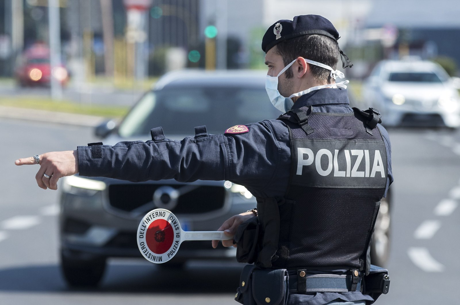 A Police officer stops and check vehicles in Rome, Saturday, April 11, 2020. (AP Photo)