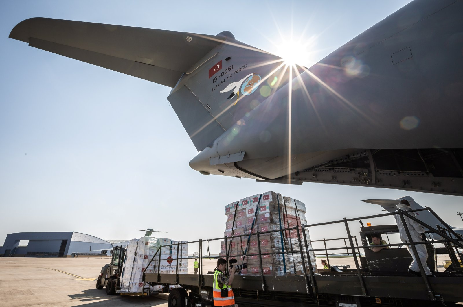 Crucial supplies of personal protective equipment (PPE) for medical staff have been delivered from Turkey to a Royal Air Force base for distribution around the country, amid the coronavirus outbreak, in Carterton, U.K., April 10, 2020. (Handout via Reuters)