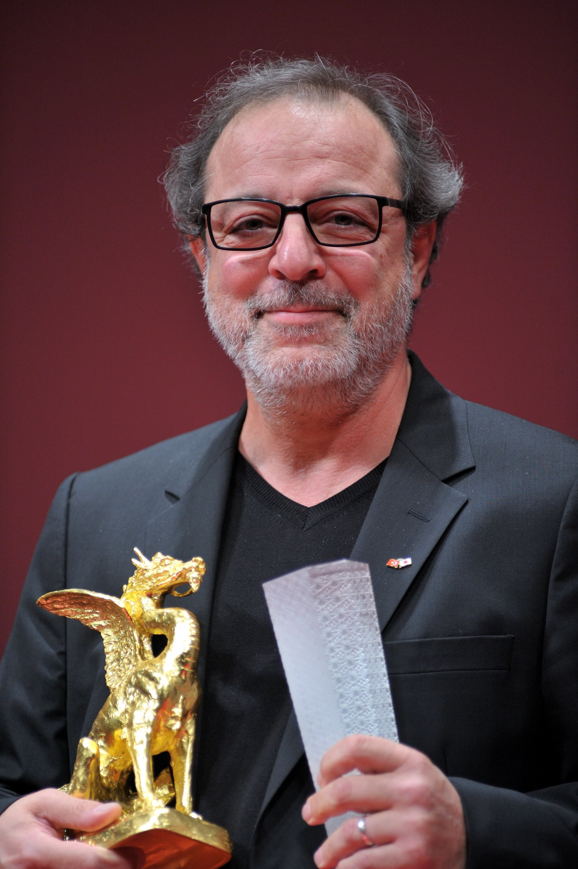 Semih Kaplanoğlu poses with the Grand Prix for his film