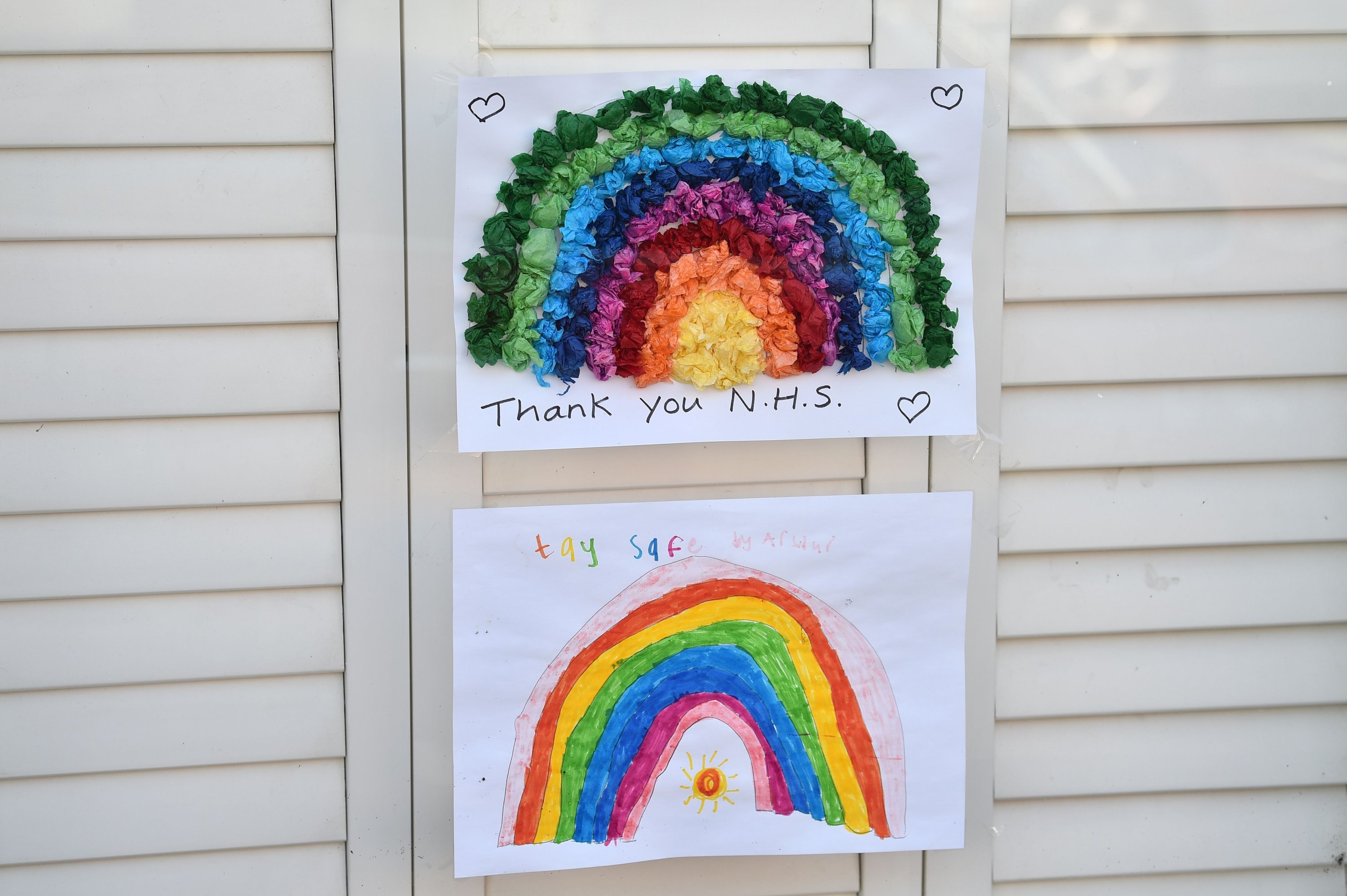 Rainbow pictures, offering messages of hope to the public and support for the National Health Service (NHS) are seen in the window of a house in Arundel, southern England, April 10, 2020. (AFP Photo)