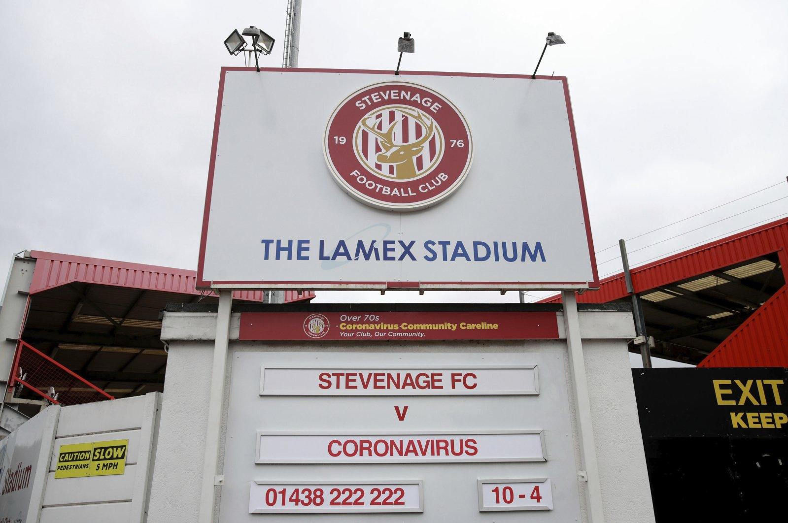 The Lamex Stadium, home of Stevenage football club, where the upcoming fixture board shows Stevenage FC v Coronavirus, Sunday, March 29, 2020. (AP Photo)