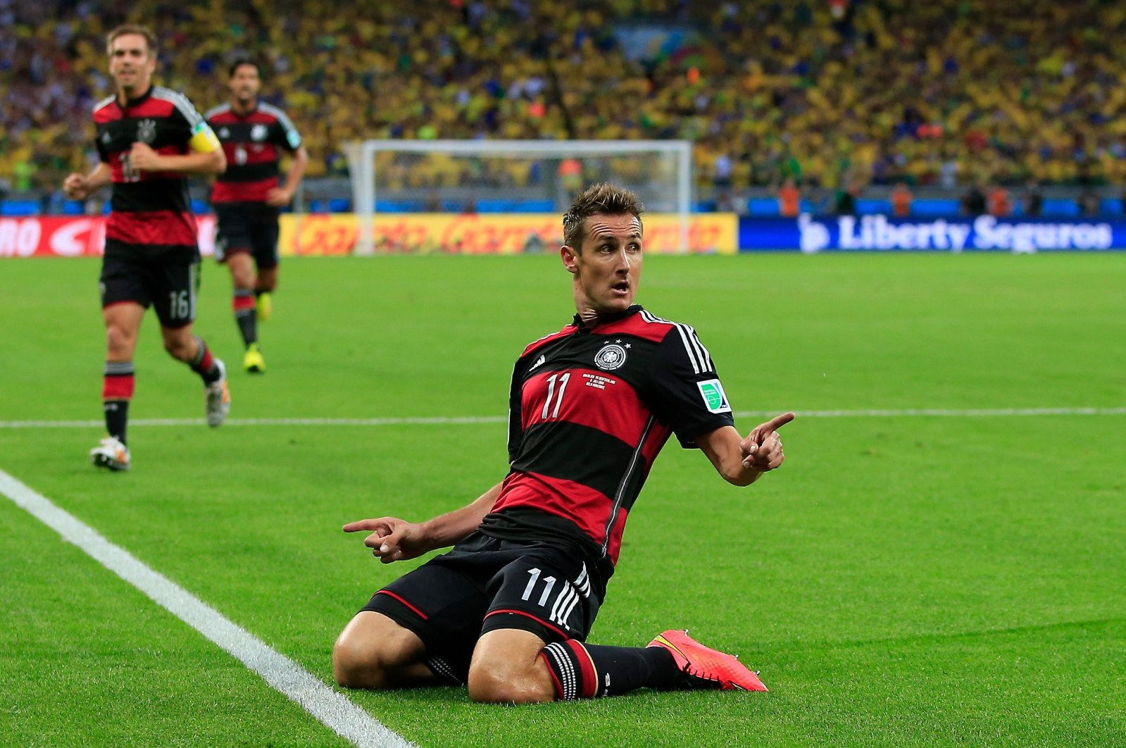Miroslav Klose celebrates after scoring during the semi-final football match between Brazil and Germany, in Belo Horizonte, Brazil, July 8, 2014. (AFP Photo)