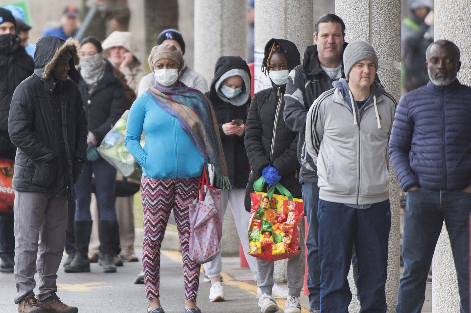 People wait in line to enter a Costco store during the COVID-19 pandemic in Montreal, Canada, April 10, 2020. (AP Photo)