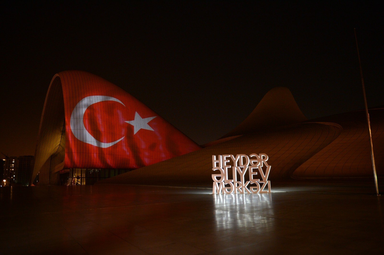 Image of Turkish flag reflected on the Heydar Aliyev Cultural Center in Azerbaijan's capital Baku on Saturday, April 11, 2020 (IHA Photo)