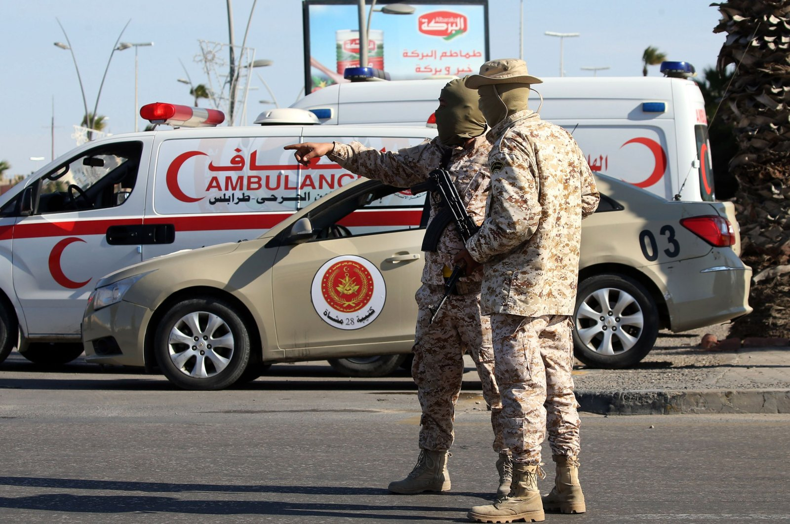 Members of the Libyan security forces man a checkpoint in the capital Tripoli, to insure that the strict measures taken by the authorities to stem the spread of the coronavirus are respected, Friday, April 10, 2020. (AFP)