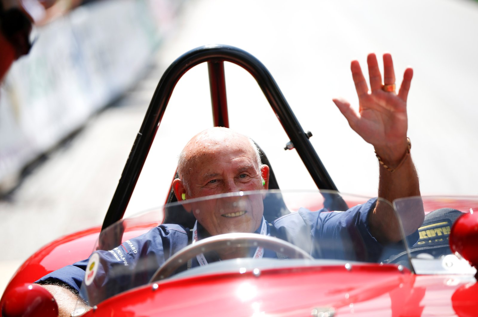 Stirling Moss waves to spectators as he sits in his 1955 Ferrari 750 Monza during the Ennstal Classic rally near the  village of Groebming, Austria,  July 20, 2013. (REUTERS Photo)