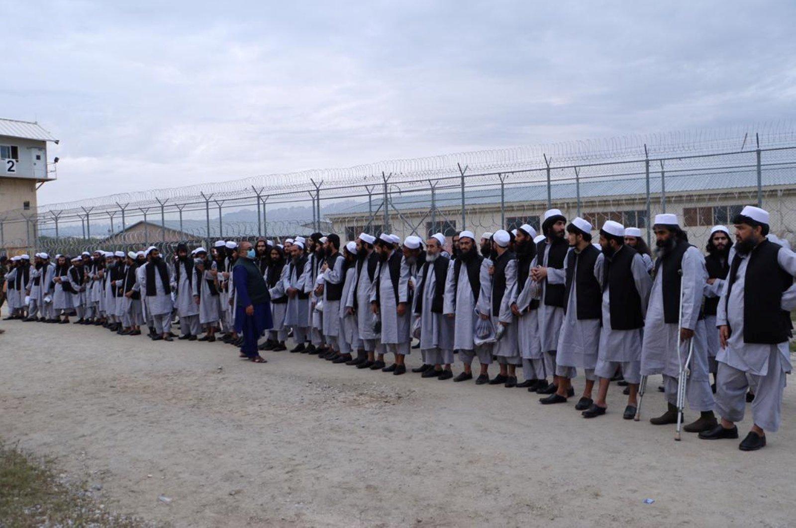 Newly freed Taliban prisoners line up at Bagram prison, Kabul, April 11, 2020. (Reuters Photo)