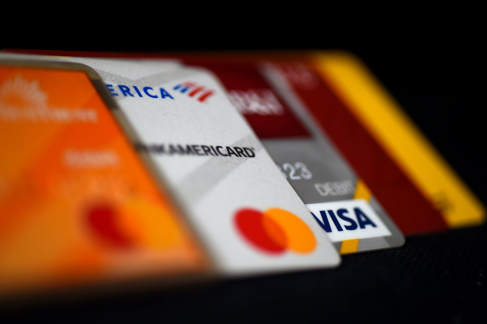 This picture shows debit and credit cards arranged on a desk in Arlington, Virginia, U.S., April 6, 2020. (AFP Photo)