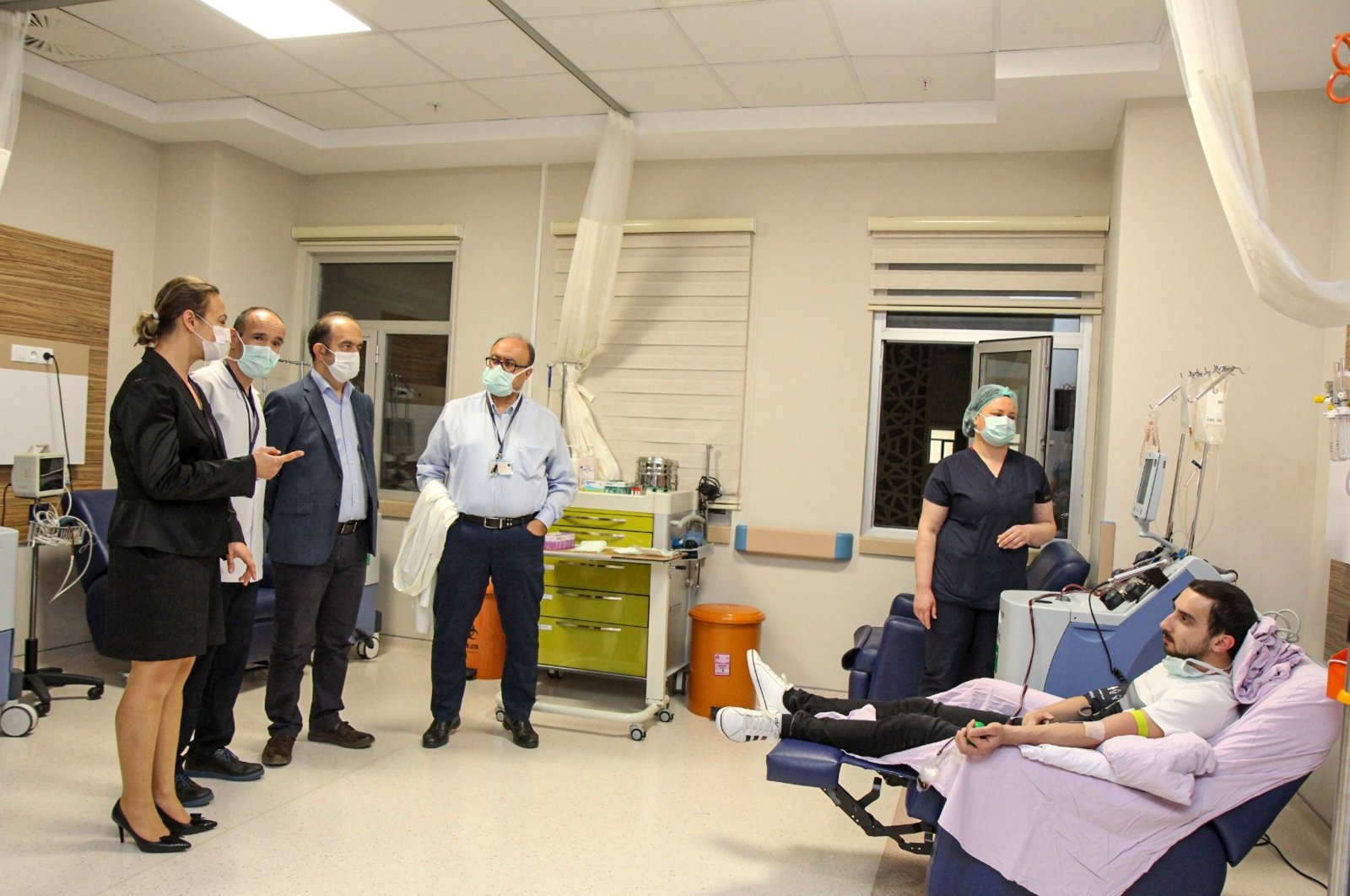 Çağlar Çolak donates plasma for a patient recovering from COVID-19, in Antalya, Turkey, Friday, April 10, 2020. (DHA Photo)