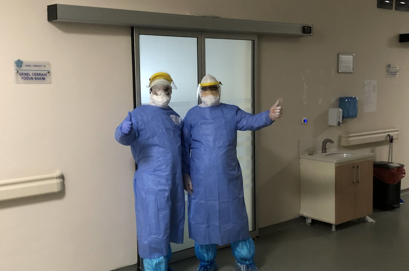 Health care staff wearing protective gearing pose outside an intensive care unit, Konya, Turkey, April 11, 2020. (PHOTO BY HALİT TURAN)