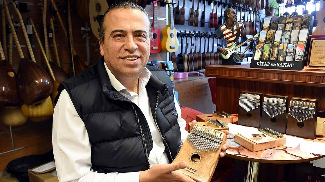 Rüstem Avcı poses with a mbira in this undated photo. (AA Photo)