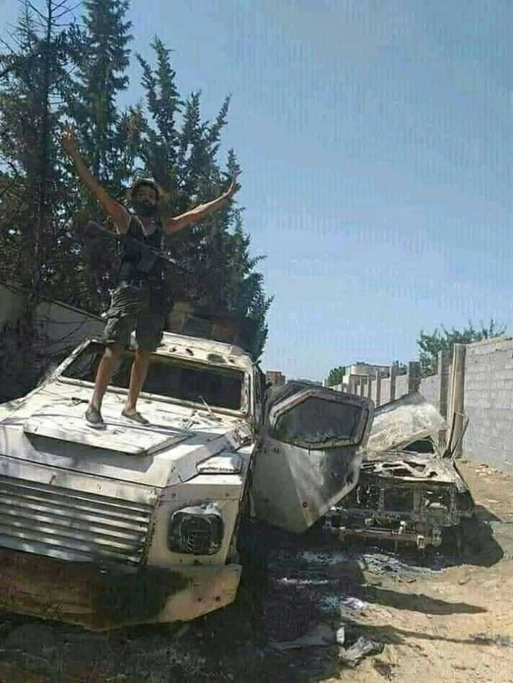 A Government of National Accord (GNA) fighter celebrates the victory on top of an Emirati-made military vehicle destroyed by Turkish drones, according to sources on the ground.