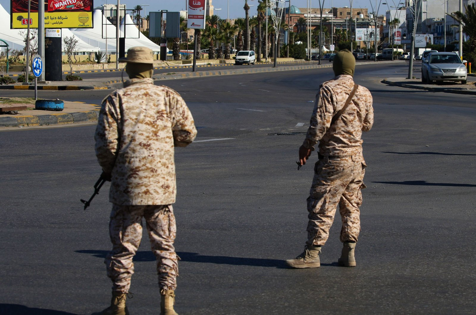 Members of the Libyan security forces man a checkpoint in the capital Tripoli, to ensure that the strict measures taken by the authorities to stem the spread of the novel coronavirus are respected, on April 10, 2020. (AFP Photo)