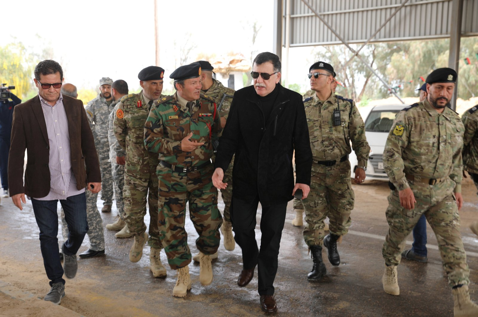 Libyan Prime Minister Fayez al-Sarraj arrives at a checkpoint after Government of National Accord (GNA) forces retook it from Khalifa Haftar-aligned militias, west of Tripoli, Libya, April 5, 2019. (Reuters Photo)