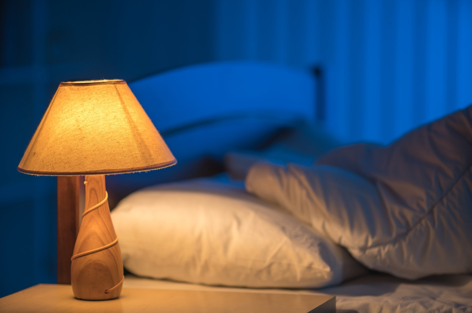 An earlier bedtime could help us shrink our carbon footprint. (iStock Photo)