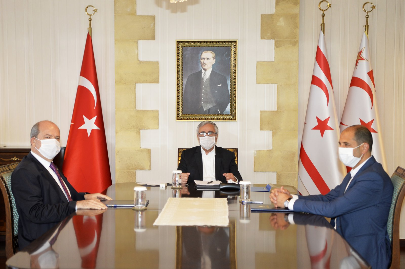 TRNC President Mustafa Akıncı (Center) holds meeting with Prime Minister Ersin Tatar and Foreign Minister Kudret Özersay to discuss developments regarding coronavirus outbreak on April 9, 2020. (AA Photo)