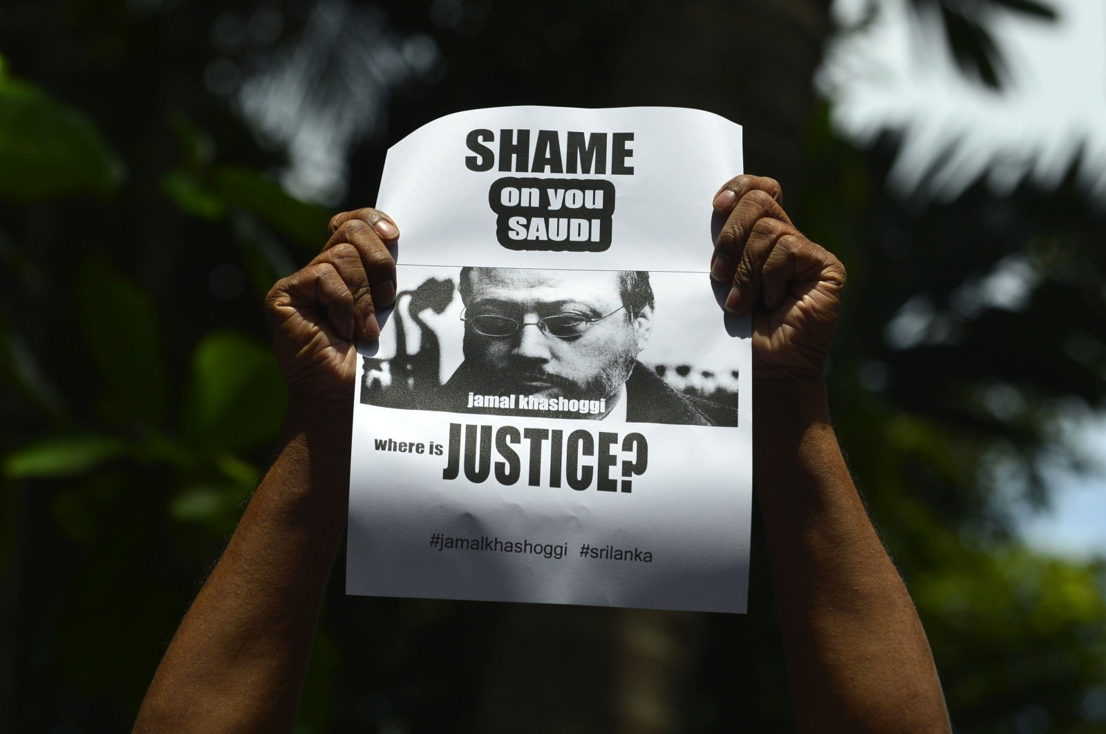 A member of the Sri Lankan web journalist association holds a poster with the image of Saudi journalist Jamal Khashoggi during a demonstration outside the Saudi Embassy in Colombo, Oct. 25, 2018.  (AFP)