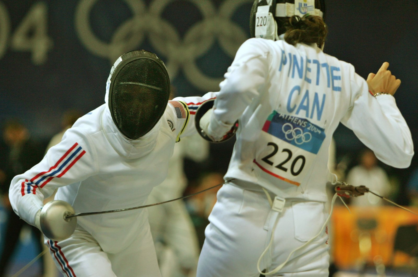 Anita Allen of the United States (L) attacks Monica Pinette of Canada during their bout in Athens, Aug. 27, 2004. (AP Photo)