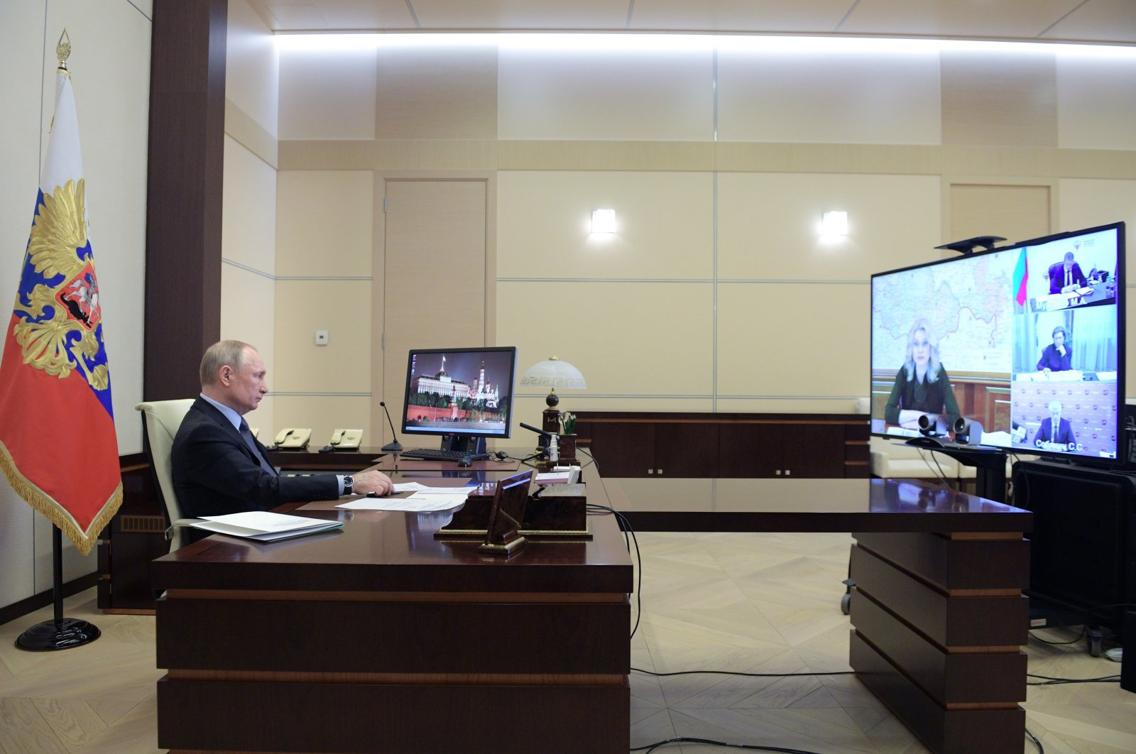 Russian President Vladimir Putin, attends a video conference at the Novo-Ogaryovo residence outside Moscow, Russia, Monday, April 13, 2020. (AP Photo)