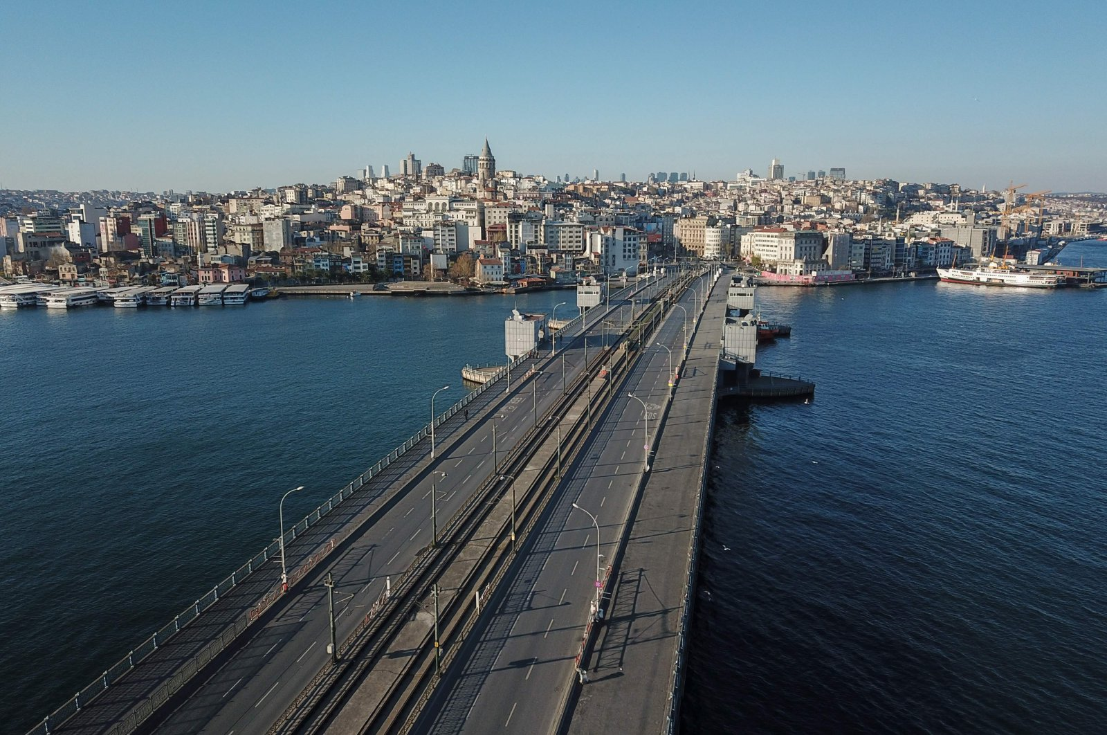 The Galata bridge and the Galata Tower in Istanbul on April 12, 2020, during a two-day curfew to prevent the spread of the epidemic COVID-19 caused by the novel coronavirus. (AFP Photo)