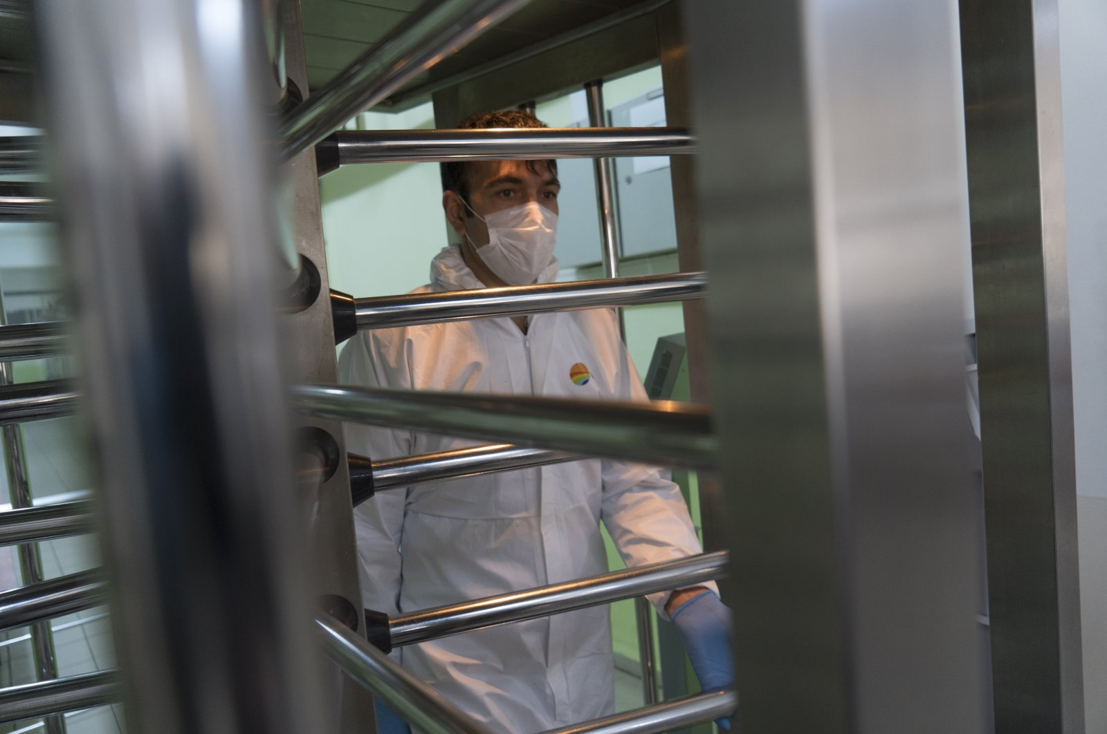 A worker exits Maltepe Prison in Istanbul after disinfecting the facility, April 7, 2020. (DHA Photo)