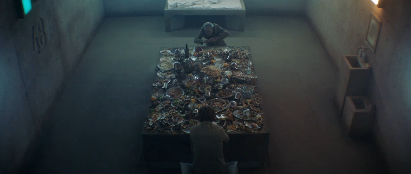 Food is served on a platform which passes through all the floors of the prison.