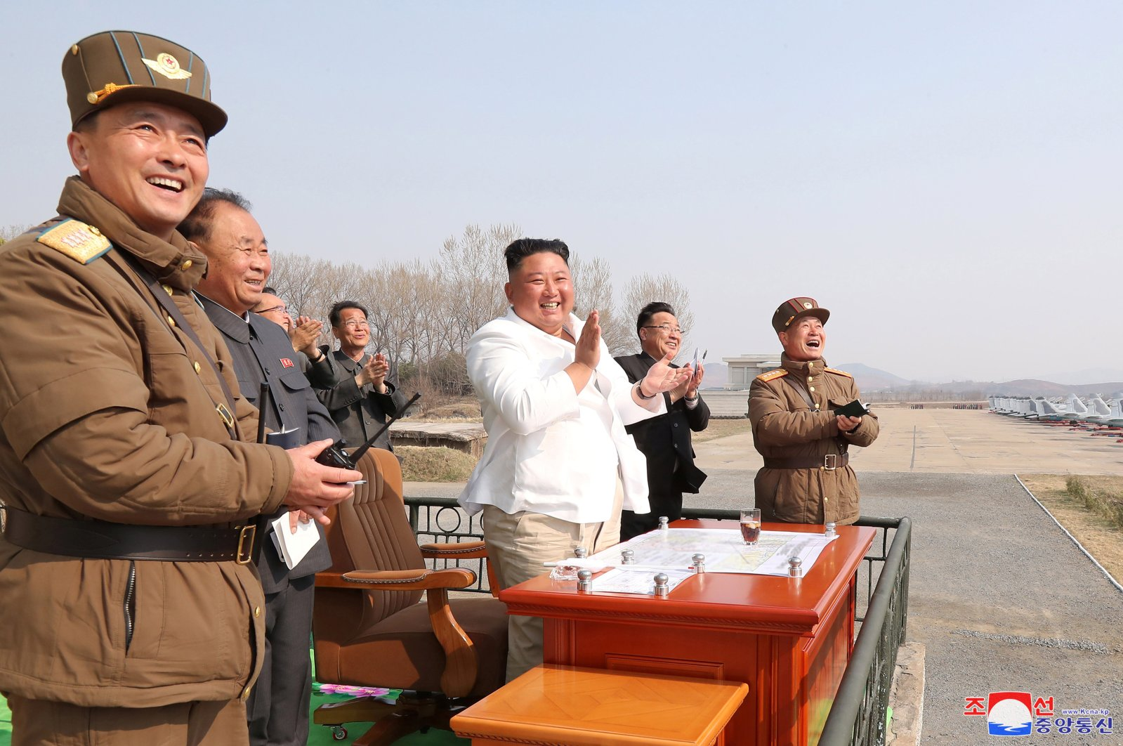 North Korean leader Kim Jong Un applauds while visiting a pursuit assault plane group under the Air and Anti-Aircraft Division in the western area in this undated image released by North Korea's Korean Central News Agency (KCNA) in Pyongyang on April 12, 2020. (KCNA/via Reuters)