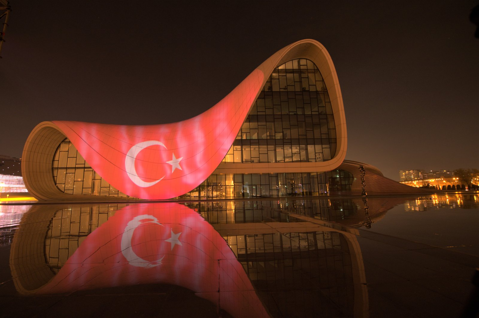 Azerbaijan displayed a digital version of the Turkish flag at the Heydar Aliyev Cultural Center, an iconic symbol in the capital Baku, in a show of solidarity amid the coronavirus pandemic, April 11, 2020. (AA Photo)