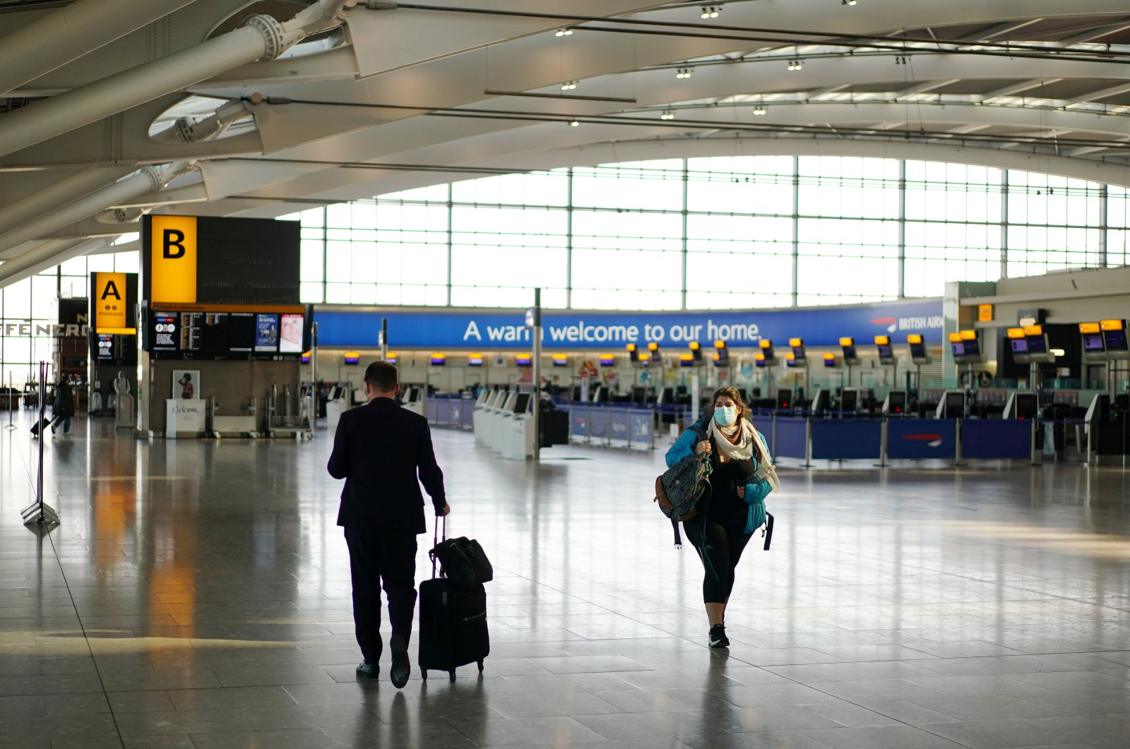 A lady wearing a mask is seen at Heathrow Airport, as the spread of COVID-19 continues, London, U.K., April 5, 2020. (Reuters Photo)
