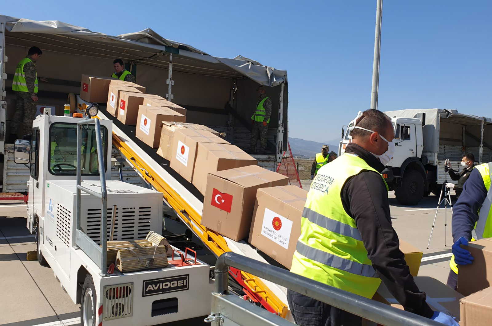 Serbian officials unload Personal Protection Equipment donated by Turkey to help the country combat the new coronavirus outbreak, in Belgrade, Serbia, Wednesday, April 8, 2020. (AP Photo)