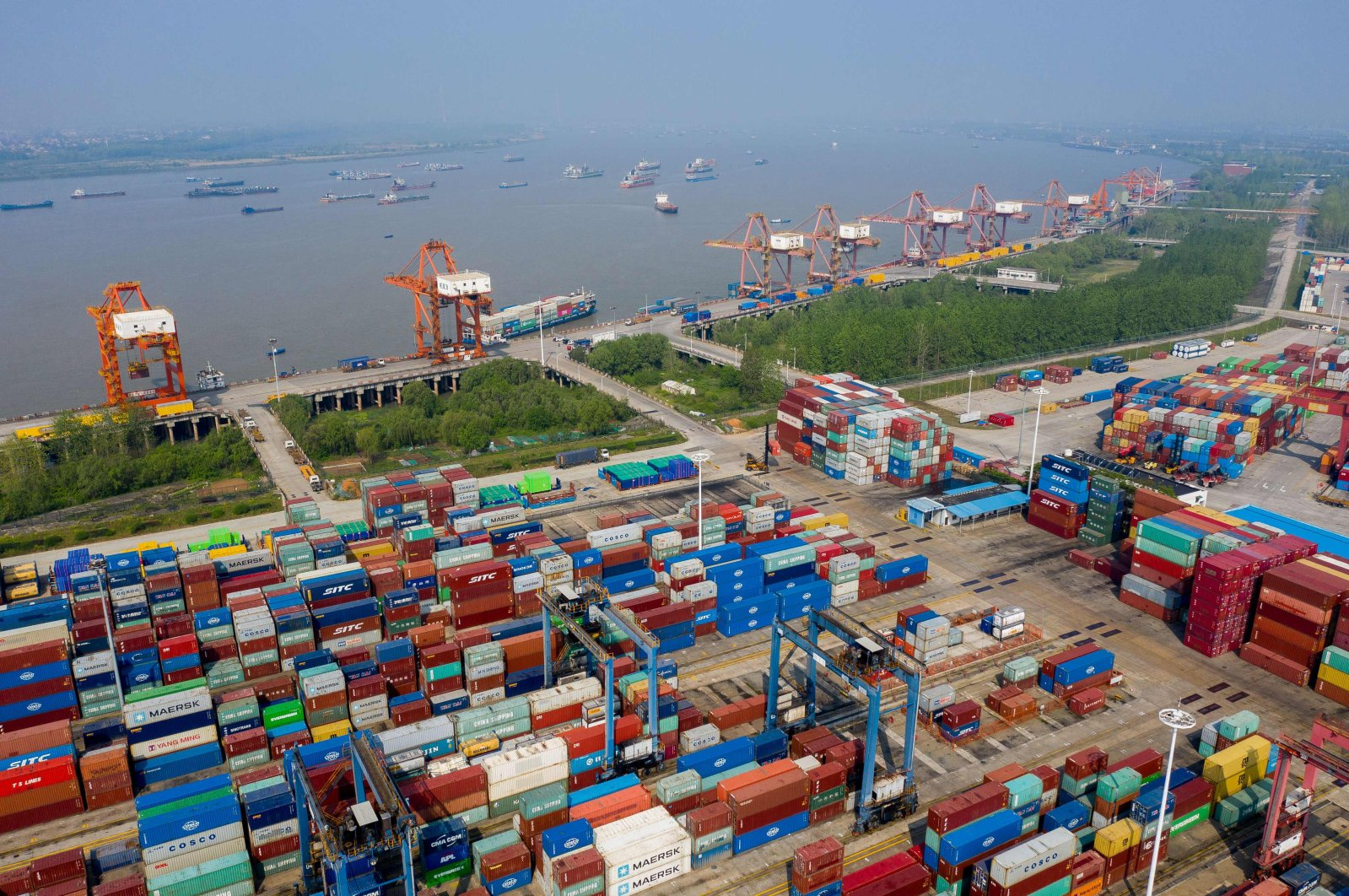 Containers are seen at the port in Wuhan, on the Yangtze river, in China's central Hubei province, April 12, 2020. (AFP Photo)