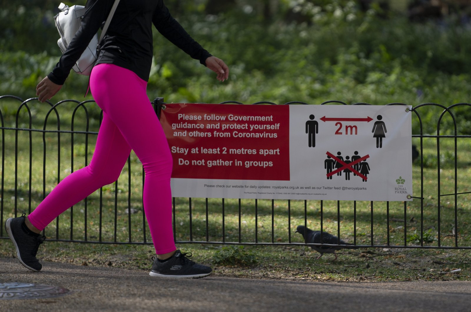 A general view of signage in St James Park, Central London Britain, Monday, April 13, 2020. (EPA Photo)