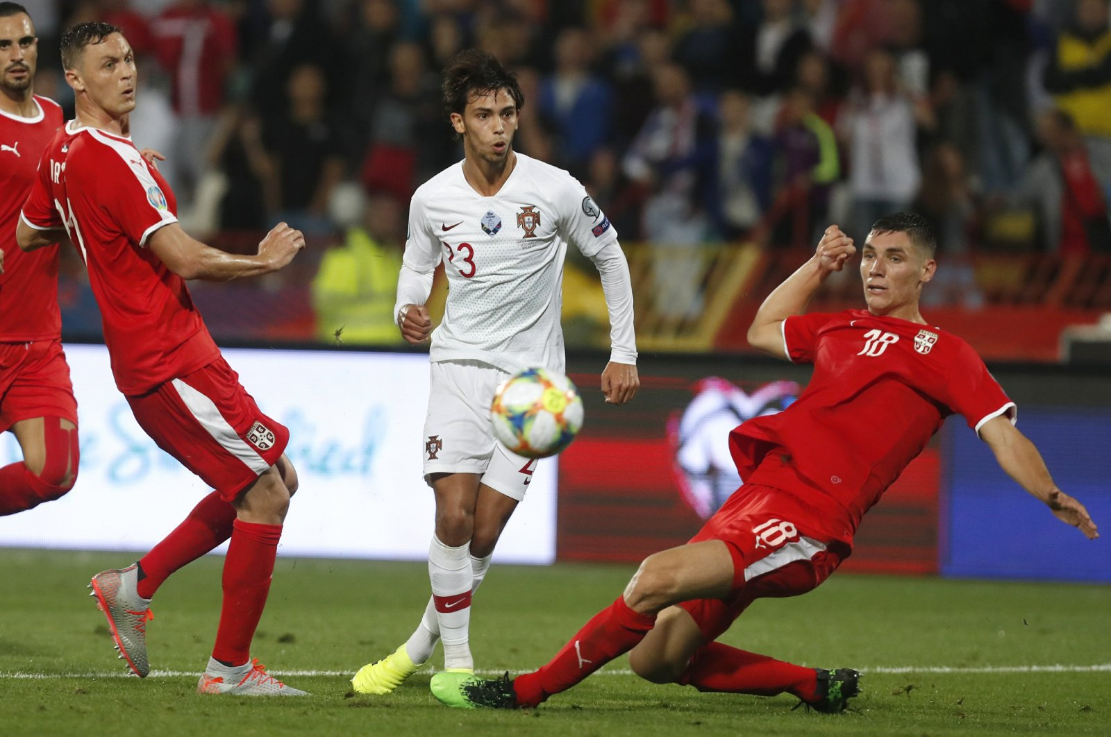 Portugal's Joao Felix, center, kicks the ball ahead of Serbia's Nemanja Matic, left, and Serbia's Nikola Milenkovic during the Euro 2020 group B qualifying match between in Belgrade, Serbia, Sept. 7, 2019. (AP Photo)